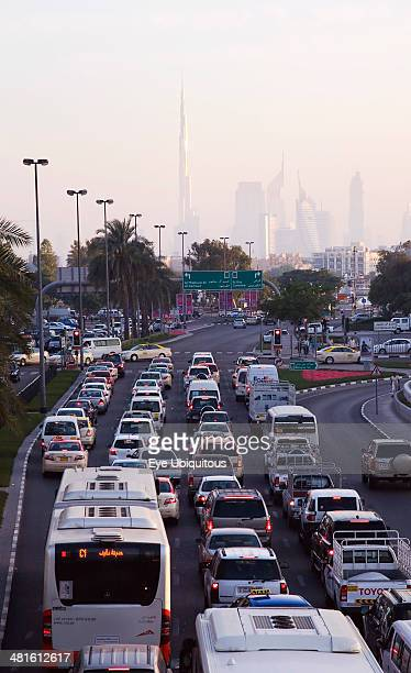 UAE Dubai Traffic in Deira during rush hour with skyline showing Burj Khalifa tower