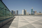 Dubai, UAE, Architectural detail of Emirates Towers plaza and surrounding buildings