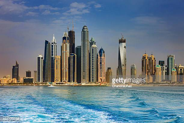 Dubai, UAE - luxurious Marina towers, late afternoon offshore shot.