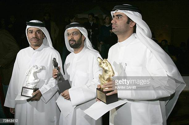 From Emirati play writers Yussef Ibrahim with a silver trophy for best scenario Ahmed Salem with a bronze trophy for best documentary scenario and...