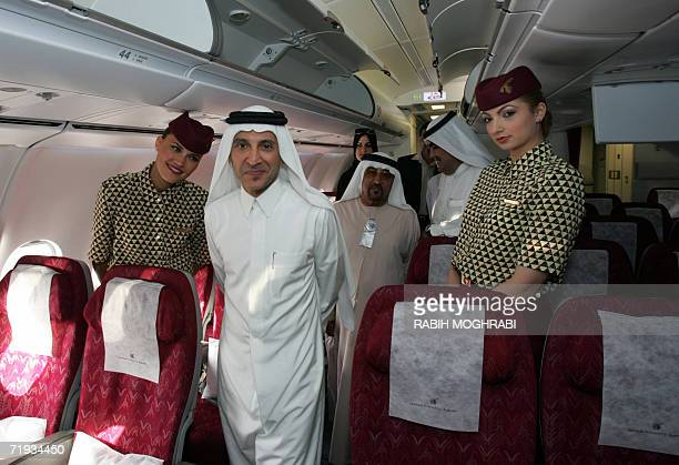 Qatar Airways chief executive officer Akbar alBaker tours with journalists the airline's brand new Airbus A340600 aircraft at Dubai international...