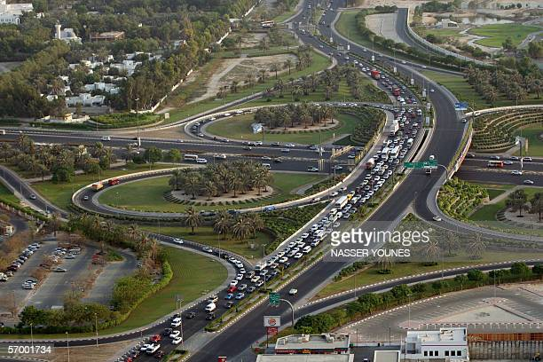 TO GO WITH AFP STORYUAETRANSPORTROADRAILDUBAI An aerial view taken 02 March 2006 shows traffic in Dubai Authorities in the booming Gulf emirate of...