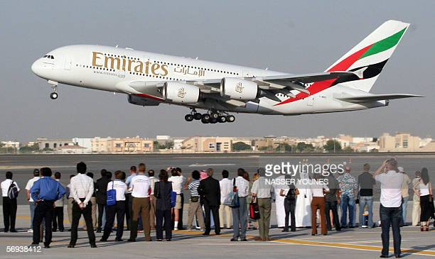 TO GO WITH 'ASIAGULFAIRLINE' This file photo dated 22 November 2005 shows Emirati and foreign visitors watching an Airbus A380 sporting the colors of...