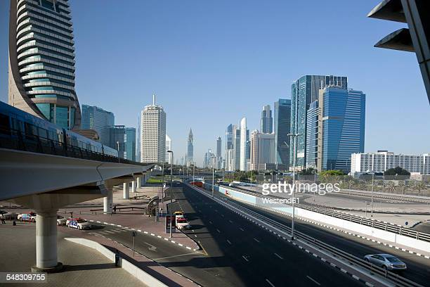 UAE, Dubai, view to Sheikh Zayed Road and driving metro