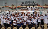 Dubai's alNasr players celebrate with their trophy after winning the United Arab Emirates President's Cup against UAE's alAhli on June 3 2015 at...