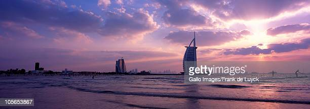 Dubai's beach with Burj Al Arab and Jumeirah Beach hotel in background, Jumeirah, Dubai, United Arab Emirates