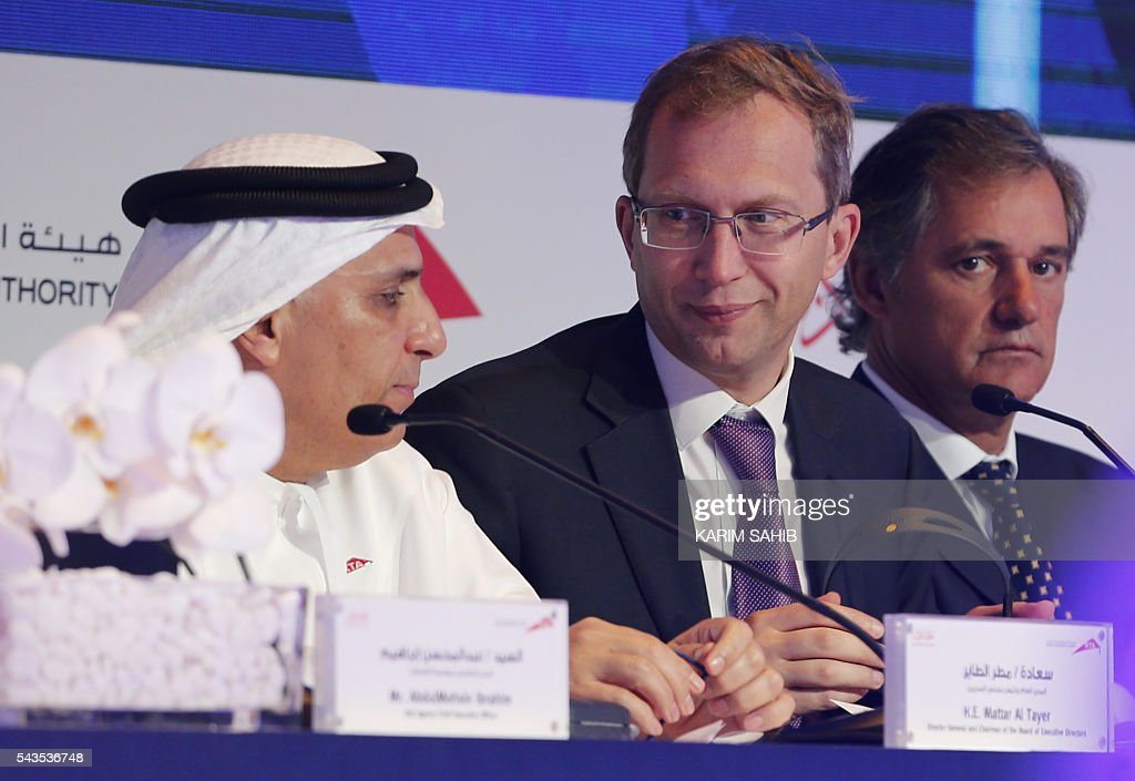 Dubai's Road and Transport Authority (RTA) chairman, Mattar al-Tayer (L), and head of French industrial giant Alstom, Henri Poupart-Lafarge (C), hold a press conference on the Route 2020 metro expansion project on June 29, 2016, in the emirate of Dubai. Dubai's transport authority announced it had awarded a French-led consortium a $2.88 billion contract to extend its metro network to the site of the Expo 2020 world trade fair. The consortium, led by France's Alstom Conglomerate and also including Spain's Acciona and Turkey's Gulermak, will construct a 15 kilometre (nine mile) extension to the site of the fair, a statement said. / AFP / KARIM