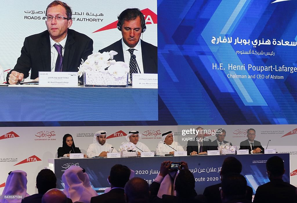 Dubai's Road and Transport Authority (RTA) chairman, Mattar al-Tayer (4th from L), and head of French industrial giant Alstom, Henri Poupart-Lafarge (3rd from R), hold a press conference on the Route 2020 metro expansion project on June 29, 2016, in the emirate of Dubai. Dubai's transport authority announced it had awarded a French-led consortium a $2.88 billion contract to extend its metro network to the site of the Expo 2020 world trade fair. The consortium, led by France's Alstom Conglomerate and also including Spain's Acciona and Turkey's Gulermak, will construct a 15 kilometre (nine mile) extension to the site of the fair, a statement said. / AFP / KARIM