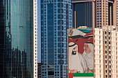 Dubai's ruler Sheikh Mohammed bin Rashid alMaktoum and his brother painted on the side of a building appear among the modern architecture that...