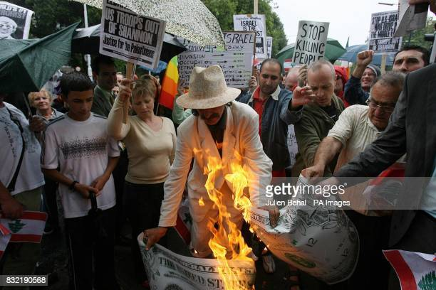Dublin Artist and Activist Gerard Dowling burning a representation of an American Dollar in rejection of the US's backing of Israel in the current...