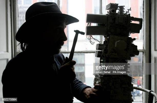 Dublin avant garde artist Gerard Dowling better known as 'Zorro of the Liffey' at work on his new sculpture to commemorate the 5th anniversary of the...