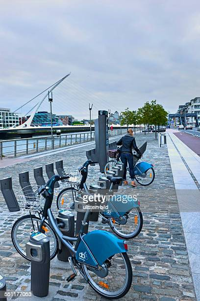 Dublin city bicycles and stands with Samuel Beckett Bridge Dublin Republic of Ireland Europe