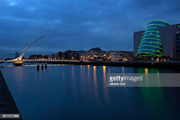 Dublin Convention center illuminated at night with the Samuel Beckett Bridge Dublin Republic of Ireland Europe