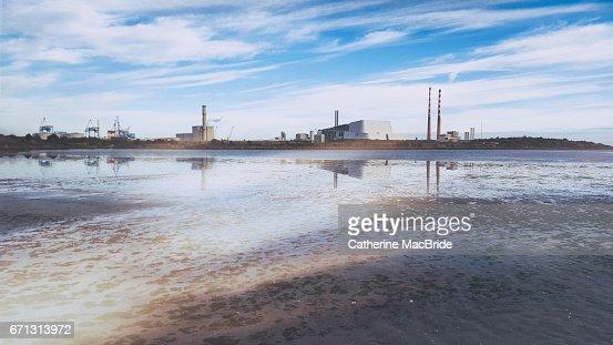 Dublin Docks viewed from Sandymount strand : Stock Photo