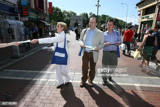 Dublin general election candidates for Fine Gael Frances Fitzgerald and Brian Hayes join TD Denis Naughton on Grafton Street handing out leaflets to...
