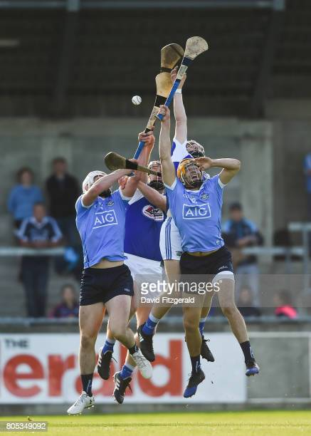 Dublin Ireland 1 July 2017 Eamon Dillon right and Liam Rushe of Dublin compete a high ball against Cahir Healy and Eric Killeen of Laois during the...