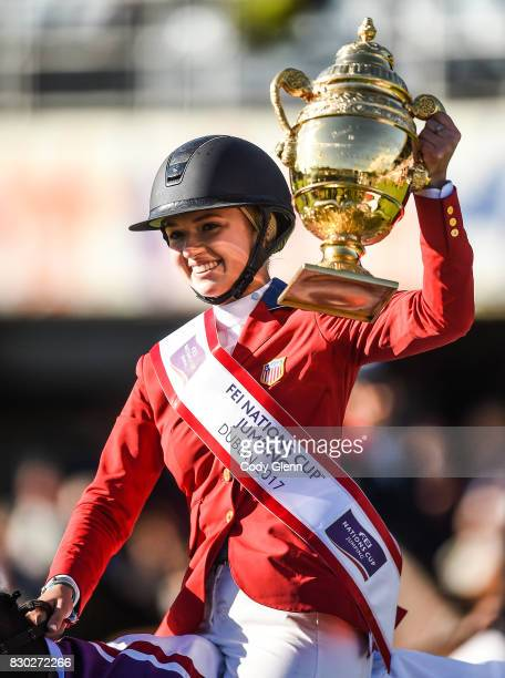 Dublin Ireland 11 August 2017 Lillie Keenan of USA lifts the Aga Khan Trophy after winning the FEI Nations Cup during the Dublin International Horse...