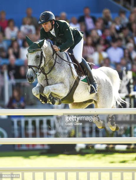 Dublin Ireland 11 August 2017 Mark McAuley of Ireland competing on Miebello during the FEI Nations Cup during the Dublin International Horse Show at...