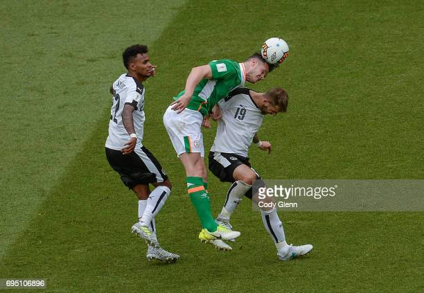 Dublin Ireland 11 June 2017 Kevin Long of Republic of Ireland in action against Guido Burgstaller and Valentino Lazaro of Austria during the FIFA...