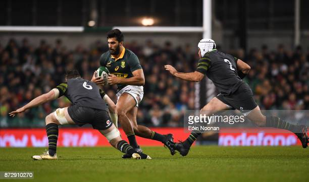 Dublin Ireland 11 November 2017 Damian de Allende of South Africa in action against Peter O'Mahony left and Rory Best of Ireland during the Guinness...