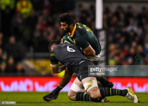 Dublin Ireland 11 November 2017 Damian de Allende of South Africa is tackled by Peter O'Mahony of Ireland during the Guinness Series International...