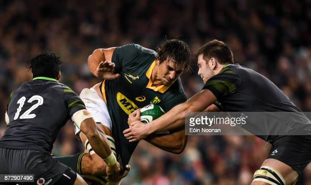 Dublin Ireland 11 November 2017 Eben Etzebeth of South Africa is tackled by Bundee Aki left and Iain Henderson of Ireland during the Guinness Series...