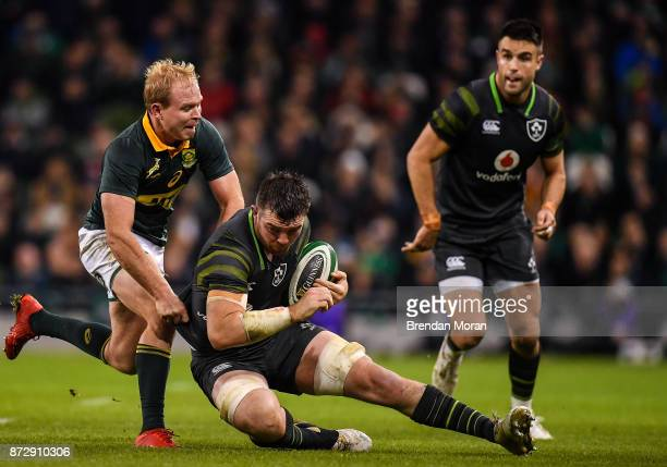 Dublin Ireland 11 November 2017 Peter O'Mahony of Ireland is tackled by Ross Cronjé of South Africa during the Guinness Series International match...