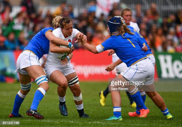 Katy Mclean of England in action against Isabella Locatelli and Marta Ferrari of Italy during the 2017 Women's Rugby World Cup Pool B match between...