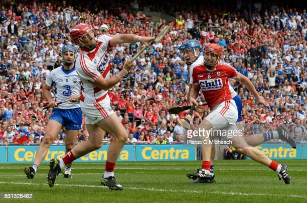 Dublin Ireland 13 August 2017 Waterford's Austin Gleeson centre shoots to score his side's third goal as teammate Michael Walsh and Cork's Anthony...