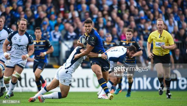 Dublin Ireland 14 October 2017 Adam Byrne of Leinster is tackled by Thomas Darmon of Montpellier during the European Rugby Champions Cup Pool 3 Round...