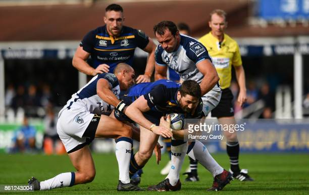 Dublin Ireland 14 October 2017 Barry Daly of Leinster is tackled by Ruan Pienaar left and Bismarck Du Plessis of Montpellier during the European...