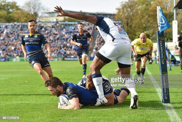 Dublin Ireland 14 October 2017 Barry Daly of Leinster scores his side's fourth try despite the tackle by Nemani Nadolo behind and Timoci Nagusa of...