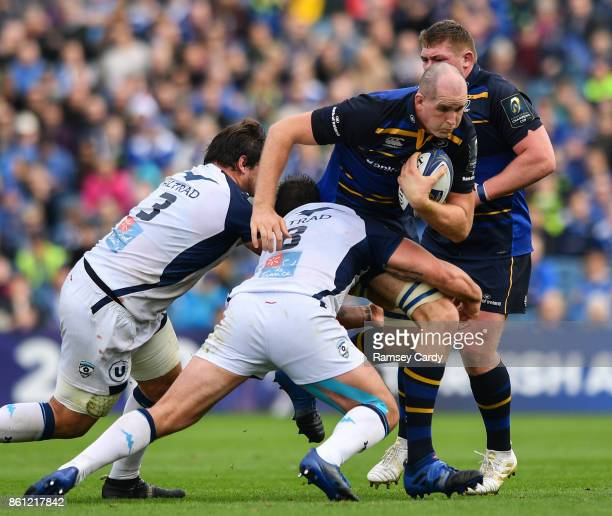 Dublin Ireland 14 October 2017 Devin Toner of Leinster is tackled by Antoine Guillamon left and Louis Picamoles of Montpellier during the European...