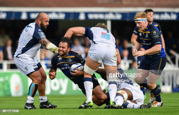 Dublin Ireland 14 October 2017 Isa Nacewa of Leinster is tackled by Mikheil Nariashvili left and Jacques Du Plessis of Montpellier during the...