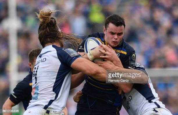Dublin Ireland 14 October 2017 James Ryan of Leinster is tackled by Jacques Du Plessis left and Kelian Galletier of Montpellier during the European...