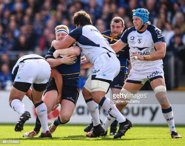 Dublin Ireland 14 October 2017 James Tracy of Leinster is tackled by Bismarck Du Plessis left and Antoine Guillamon of Montpellier during the...