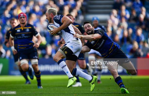 Dublin Ireland 14 October 2017 Jesse Mogg of Montpellier is tackled by Barry Daly of Leinster during the European Rugby Champions Cup Pool 3 Round 1...