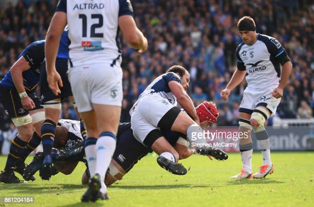 Dublin Ireland 14 October 2017 Josh van der Flier of Leinster goes over to score his side's second try despite the tackle of of Bismarck Du Plessis...