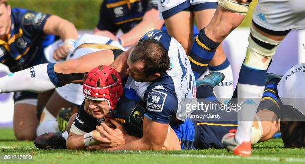 Dublin Ireland 14 October 2017 Josh van der Flier of Leinster scores his side's second try despite the tackle of Bismarck Du Plessis of Montpellier...