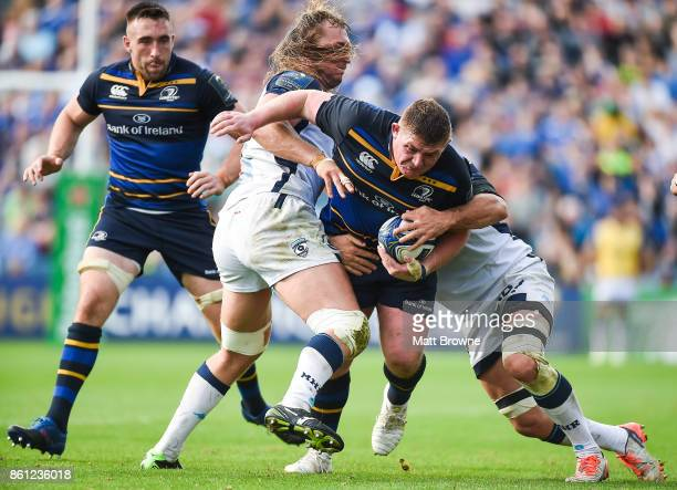 Dublin Ireland 14 October 2017 Tadhg Furlong of Leinster is tackled by Jacques Du Plessis and Kelian Galletier of Montpellier during the European...