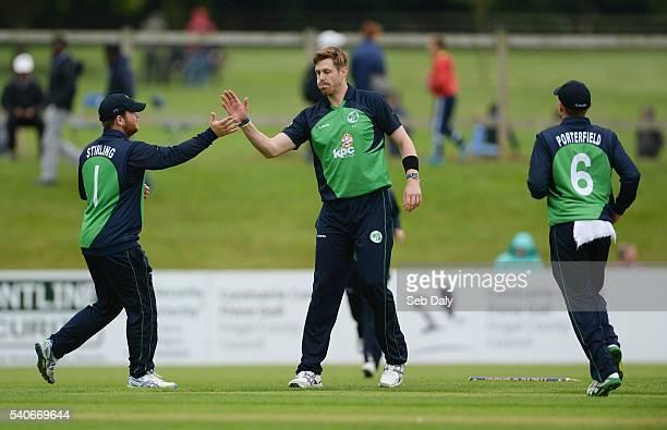 Dublin Ireland 16 June 2016 Boyd Rankin of Ireland centre is congratulated by teammate Paul Stirling after bowling out Sri Lanka's Dasun Shanaka...
