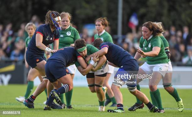 Dublin Ireland 17 August 2017 Ciara Griffin of Ireland is tackled by Gaelle Mignot and Audrey Forlani of France during the 2017 Women's Rugby World...