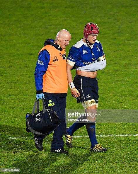 Dublin Ireland 17 February 2017 Josh van der Flier of Leinster leaves the pitch with an injury accompanied by team doctor Dr Jim McShane during the...