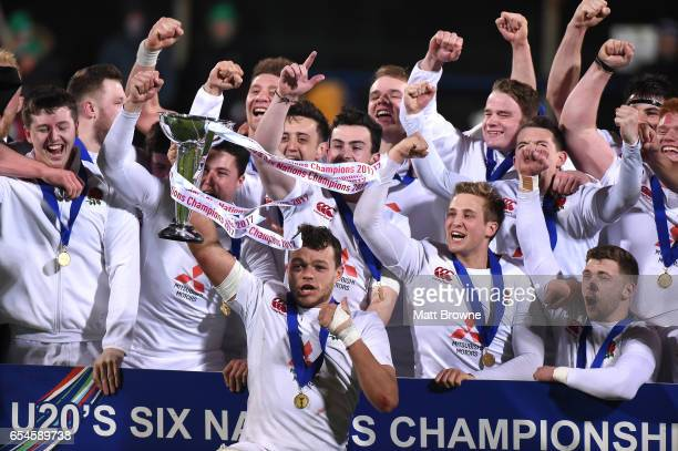 Dublin Ireland 17 March 2017 England captain Zach Mercer lifts the cup as his teammates celebrate after the RBS U20 Six Nations Rugby Championship...