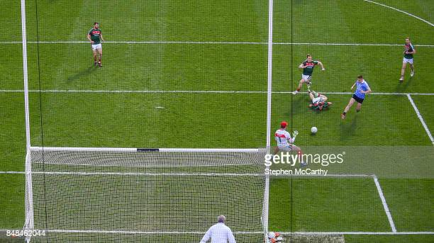 Dublin Ireland 17 September 2017 Con O'Callaghan of Dublin shoots to score his side's first goal past Mayo goalkeeper David Clarke during the GAA...