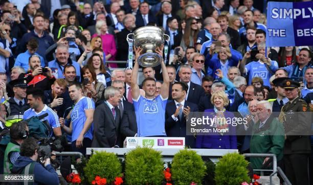 Dublin Ireland 17 September 2017 Paul Mannion of Dublin lifts the Sam Maguire Cup after the GAA Football AllIreland Senior Championship Final match...