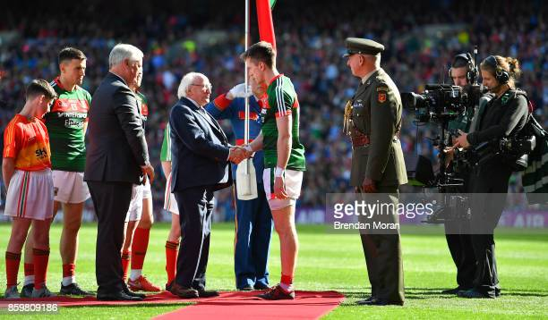 Dublin Ireland 17 September 2017 President of Ireland Michael D Higgins shakes hands with Mayo captain Cillian O'Connor after meeting both teams...