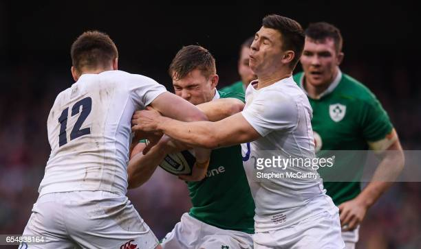 Dublin Ireland 18 March 2017 Garry Ringrose of Ireland is tackled by Owen Farrell left and Ben Youngs of England during the RBS Six Nations Rugby...