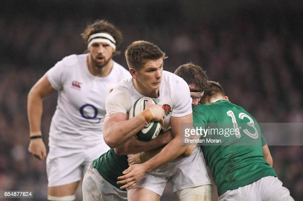 Dublin Ireland 18 March 2017 Owen Farrell of England is tackled by Donnacha Ryan left and Garry Ringrose of Ireland during the RBS Six Nations Rugby...