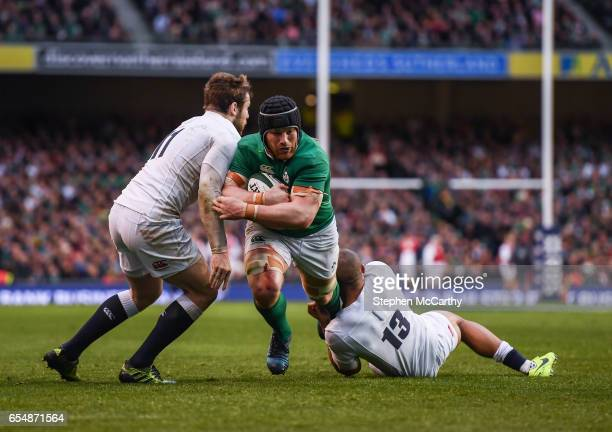 Dublin Ireland 18 March 2017 Sean O'Brien of Ireland is tackled by Elliot Daly left and Jonathan Joseph of England during the RBS Six Nations Rugby...